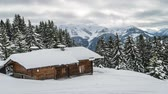 chalet : Chalet lost in the mountain with a lot of snow in Switzerland, zoom in