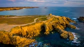 bretagne : Drone view of Quiberon in France at sunset, zoom in Stock Footage