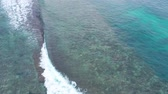 Coast as a background from top view. Turquoise water background from top view. Summer seascape from air. Bali island, Indonesia. Travel - video