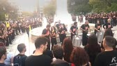 протест : Athens, Greece 19 October 2019. People playing music to protest against human trafficking in Syntagma square in Athens.