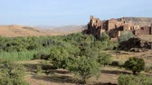 kasbah : Ancient clay Tamedakhte city near Ouarzazate and Atlas mountains in Morroco Stock Footage