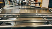 shopping bag sale : Big supermarket shopping cart in motion goes between blurred shelves. Color graded Stock Footage