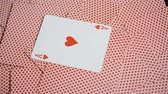 asso : playing cards red background and ace of hearts