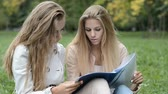 not defteri : two beautiful female students doing homework