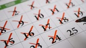 datas : Signing a day on a calendar hd footage Vídeos