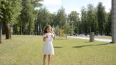 przyjaźń : two little children girl and girl playing outdoors and blowing soap bubbles