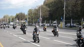 モト : Minsk, Belarus - September 14, 2019: convoy of motorcyclists moving along the road in Minsk, Independence Avenue, closing of the motorcycle season, police escort