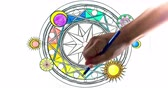 malarstwo : Coloring Book. Two hands drawing colors to a coloring book.