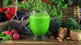 zdrowy styl życia : Green Kale and Spinach Juice filled in a glass on a healthy vegetable table Wideo