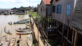 сок : Fisherman boats are starting to sail on a river from a village in Cambodia MF