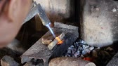 cambojano : CAMBODIA - June 5, 2017: Close up a cambodian woman forging a silver object EDI MF
