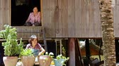 huzur : CAMBODIA - June 6, 2017: Two women are looking and smiling while working in their Cambodian wooden house EDI MF