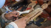 Cambodian artist is working on a wood godness figurine Wideo