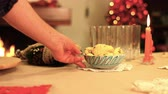 kuru üzüm : Slow motion on Italian Christmas warmth table serving cakes with chimney and candles k37 SF Stok Video