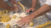 An italian pastry chef is kneading cakes and pastries with flour, sugar and nuts. 23 SF