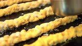 kuru üzüm : An italian pastry chef is Decorating traditional pastries with hazelnuts 8 FDV Stok Video