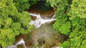 4k aerial view over beauty waterfall moving down and tilt camera Stok Video