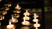 chamas : Prayer candles, or Votive candles in a church.