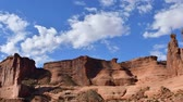 eroze : Time Lapse at Arches national Park, Utah. Clouds moving toward camera. Camera panning left to right.