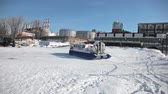 Hovercraft on the ice of the bank of frozen Volga River in Samara, Russia Стоковые видеозаписи