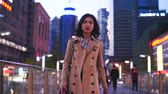 slow motion  of one pretty young asian woman walking in the city street  at evening Wideo