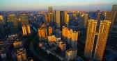aerial view of Chengdu city in morning golden sunlight, Downtown Chengdu urban cityscape with residential and office buildings together by the river, big city in Sichuan China