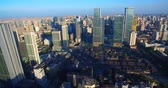 Aerial view of Chengdu City in the morning sunlight, dense residential building near the office building under the blue sky, the Taikoo Li Mall area with traditional Asian style building. Wideo