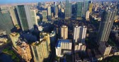 chengdu : Aerial view of Chengdu City in the morning sunlight, dense residential building near the office building under the blue sky, the Taikoo Li Mall area with traditional Asian style building. Stock Footage