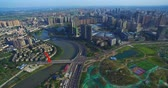 chengdu : Aerial view of New Chengdu City in sunshine with some construction site, cars running on the road by the river. 4k drone China cityscape footage Stock Footage