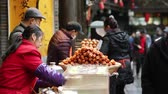 chengdu : Chengdu SichuanChina-January 15 2019: Chengdu local delicacy food stall in Jinli street, mature woman making food when tourist walking.