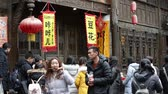 Chengdu SichuanChina-January 15 2019: Chengdu local delicacy food stall in Jinli street,  tourist walking while eating snacks Wideo
