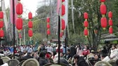 chengdu : Chengdu SichuanChina-January 15 2019: tourist relax sitting in teahouse in Jinli street,  tourist walking while eating snacks, red lanterns hanging in air.