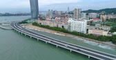 Aerial view of Xiamen Cityscape of Fujian China, seaside city, cars driving on the highway on the sea, China city 4k drone footage. Videos