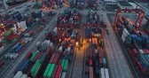 aerial above view of the container port in Shenzhen China in the evening. 4k drone footage of global trade and logistics.