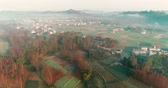 Aerial shot of beautiful Chinese New countryside village in the morning sunlight, with mist floating on the farm land field, dawn redwood, Beautiful China 4k drone footage