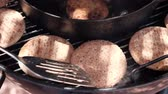 spatula : Frying squid cutlets on grill