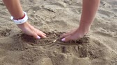 Female hands dig in sand and find gold bitcoin
