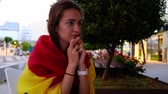 Female football fan cheering for Spain