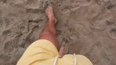 Male feet on the beach at seaside Stock Footage
