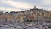 MARSEILLE, FRANCE - 10 Nov 2018 - The Old Port Vieux Port of Marseille with Basilique Notre-Dame de la Garde at the background in 4k Vídeos