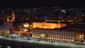 Panoramic top night view of the port, local buildings with illumination, mountains in the beautiful city of Messina, Sicily, Italy in 4k