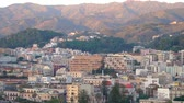 Panoramic view of the buildings on the side of the port and the mountains in Messina, Italy in 4k