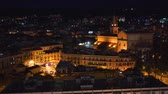 Panoramic top night view of the local buildings with lights, mountains in the beautiful city of Messina, Sicily, Italy in 4k