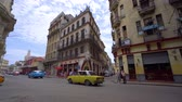 gyarmati : HAVANA, CUBA - MAY 13, 2018 - People and old taxi cars on the streets in 4k