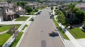 이웃 : Suburban neighborhood street with big villas next to each other in Black Mountain, San Diego, California, USA. Aerial view of residential modern subdivision luxury house. 무비클립