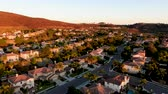 neighbor : Aerial view of residential modern subdivision luxury house neighborhood during sunset. South California, USA