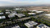distrito financeiro : Aerial view of business and finance district with new office building surrounded by parking and road. Irvine Business Complex. Irvine California. USA