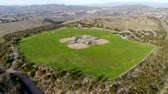 野球 : Aerial top view of Community park baseball sports field. Black Mountain Ranch Park, San Diego, USA 動画素材