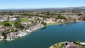 woodbridge : Aerial view of North Lake surrounded by residential neighborhood during blue sky day in Irvine, Orange County, USA