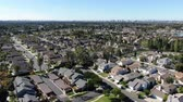 jelzálog : Aerial view of residential suburban packed homes neighborhood during blue sky day in Irvine, Orange County, USA Stock mozgókép